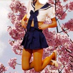 桜を背景にエロセーラー服姿でひざで立っている