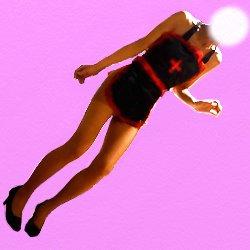 黒と赤の裸エプロンで立っている斜めの画像